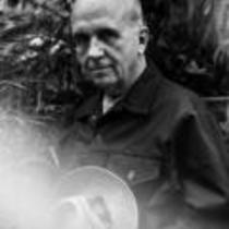 James A. Michener poses against a tropical background, ca. unknown