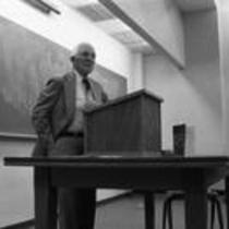 Dr. Martin Candelaria standing at a classroom podium, rededication of Candelaria Hall, 1989