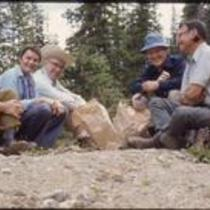 James Michener, John Kings, Tessa Dalton, and two unidentified men eat sack lunches