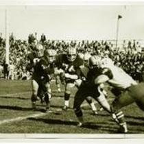 Action shot of members of the Colorado State College football team during a game, 1967.