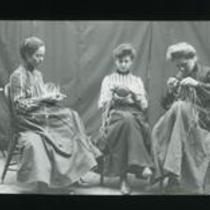 [Three women weaving]