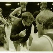 Basketball coach, Ron Brillhart, talks with members of the University of Northern Colorado basketball team.