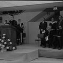 Dr. Richard R. Bond, university president, speaking at podium during Michener Library dedication, 1972