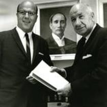 President Darrell Holmes and Dr. William Ross pose in front of a portrait of President Zachariah Xenophon Snyder