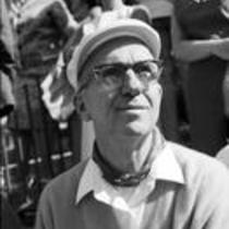 James A. Michener sitting in the audience at a stadium