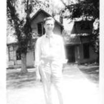 John E. Courtney Poses in Front of the Pines