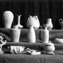 Ceramic vases, pots, and sculptures on display