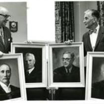 President William Ross and Richard Ellinger holding portraits of past presidents