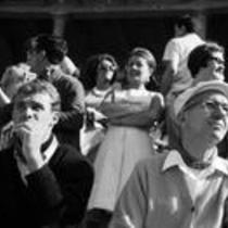 James A. Michener and unidentified man sitting in a stadium