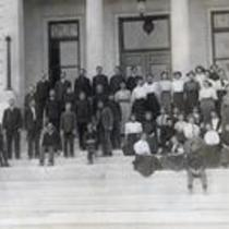 Men and women pose on the front steps of Carter Hall, State Normal School