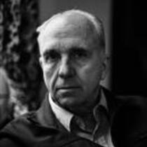 Portrait of James A. Michener sitting on a couch.