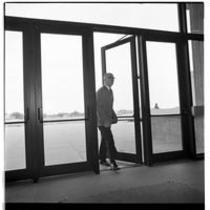 James A. Michener enters Michener Library, ca. 1972