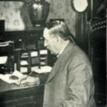 Zachariah Xenophon Snyder writing at a desk