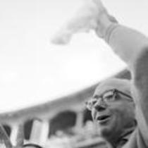 James A. Michener in a stadium, waving a handkerchief