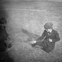 Two boys with a wooden spindle and string, State Normal School campus