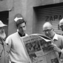 James A. Michener conversing with friends in the street