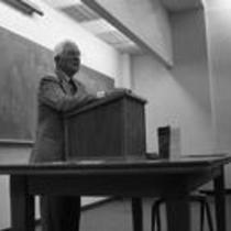 Dr. Martin Candelaria standing at a classroom podium