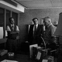 Thomas C. Harris, Dr. J. Gilbert Hause, and James A. Michener stand in an office in Michener Library, ca. 1972