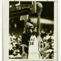 Layup action shot during a University of Northern Colorado vs. Adams State basketball game, ca. 1970s.