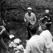 James A. Michener, Kenneth Vanderford and John Fulton stand in a forest with friends