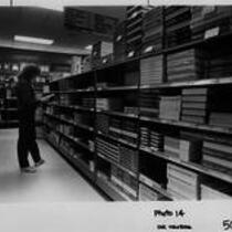 Student browsing in the University Center bookstore, ca. 1980s