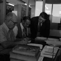 James A. Michener, Thomas C. Harris, and Dr. J. Gilbert Hause in an office in Michener Library, ca. 1972
