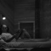 James A. Michener reading in bed