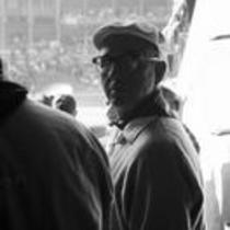 James A. Michener entering a stadium