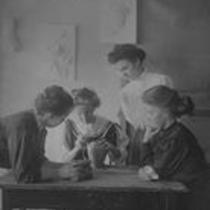 Woman working on a pottery vase, State Normal School