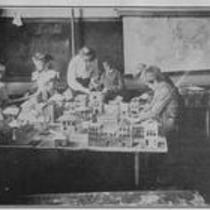 Teacher and students at work on a diorama, State Normal School campus