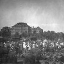 Group of men, women, and children in a garden, State Normal School campus