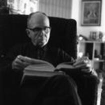James A. Michener reading a book, ca. 1960s