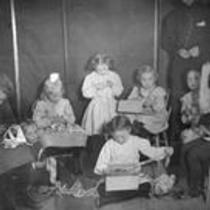 Children working with cloth, State Normal School