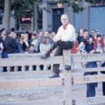 James A. Michener sitting on a fence post